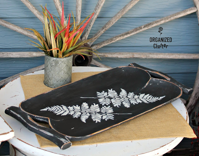 Photo of black tray with stenciled fern fronds