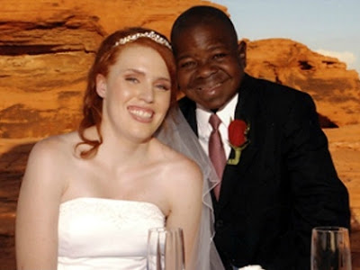 Gary Coleman with his wife in their wedding dress