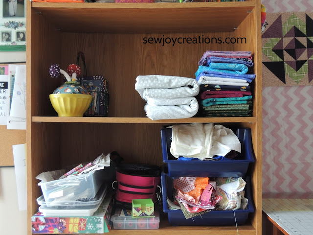 sewing room bookcase folded fabric scrap bins