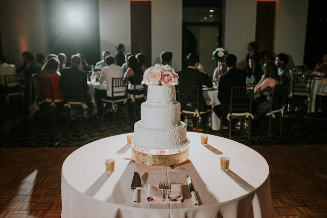 wedding cake in a crowded room on the dance floor