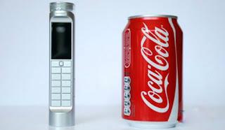 اغرب من الخيال إختراع أول هاتف محمول يشحن عن طريق مشروب الكوكاكولا #شاهد بنفسك