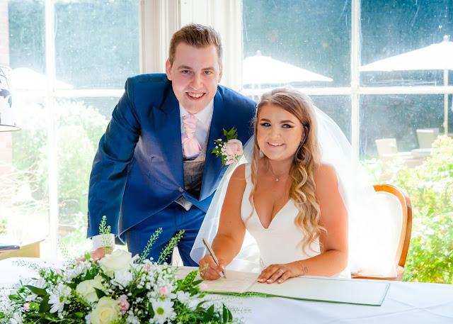 Bride and groom sign registry