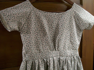 Close up of smooth infant bodice on girl's dress.