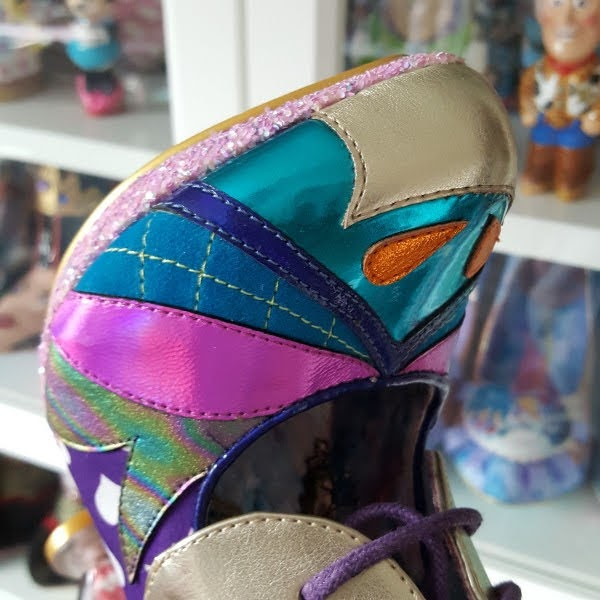 close up of pointed toe shape of shoe with metallic and embroidered materials