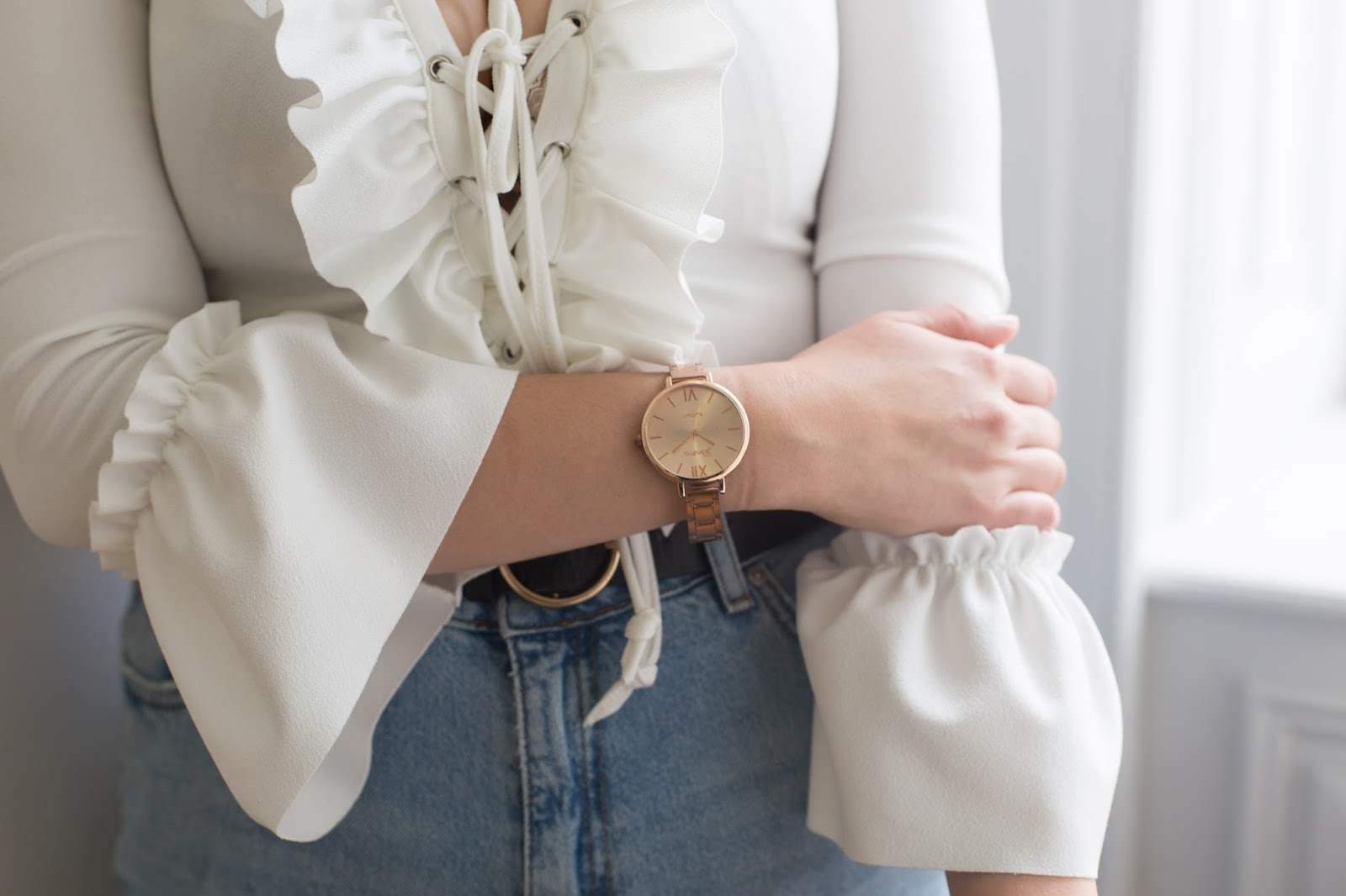 Close up image of New Look white ruffle blouse