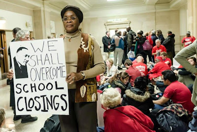 Protestor Hold Sign About School Closings