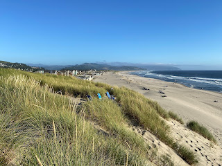 Beach chairs in the dunes at Pacific City, looking south toward Bob Straub State Park.