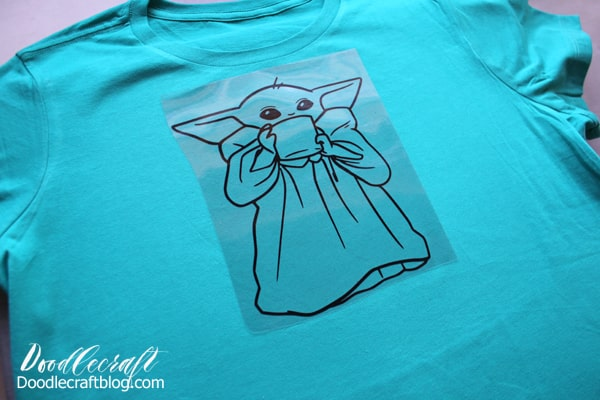Use the Cricut Maker to cut iron-on vinyl of the Child, or baby yoda, on a shirt.