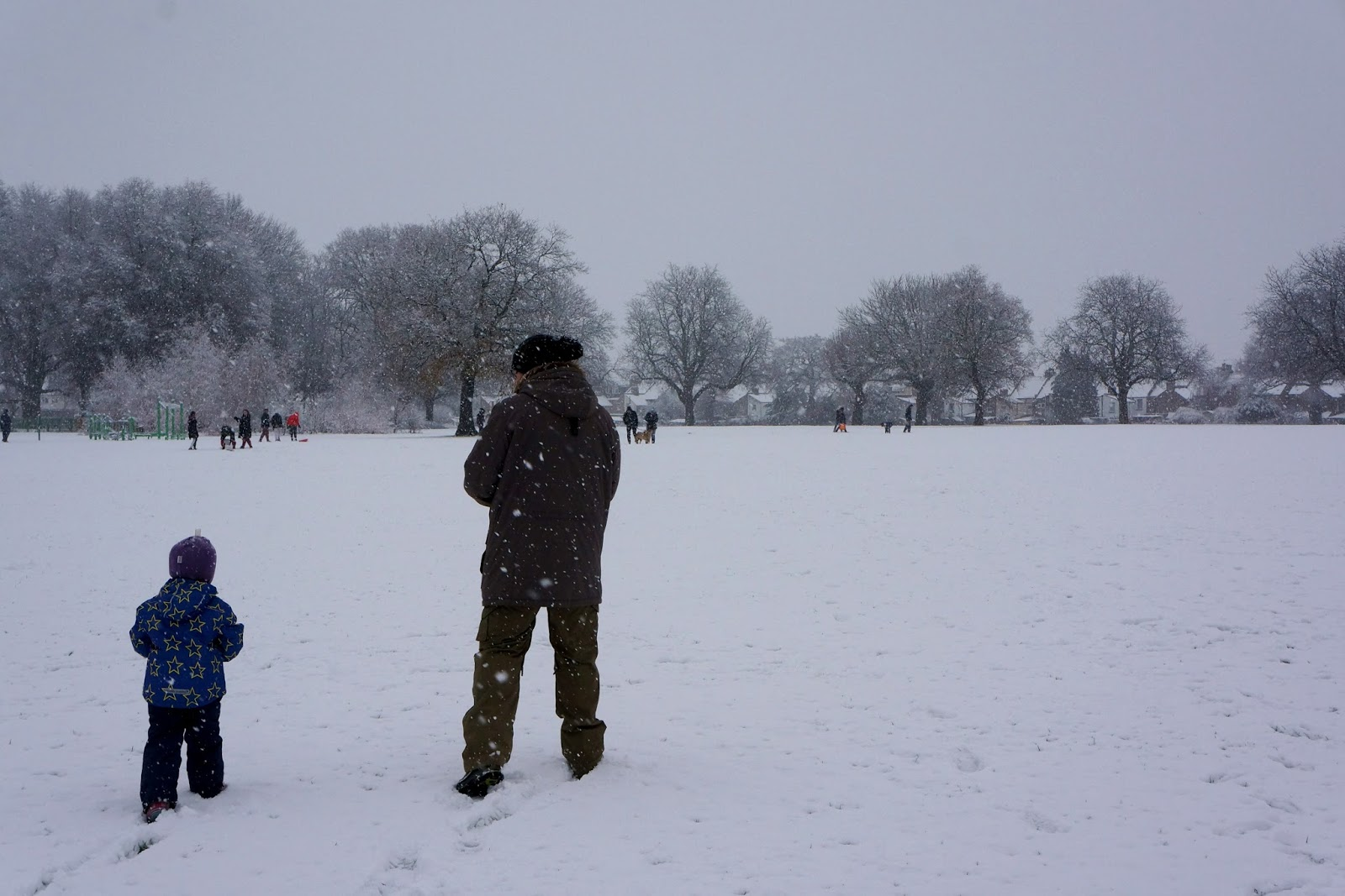 dad and daughter walking in snow