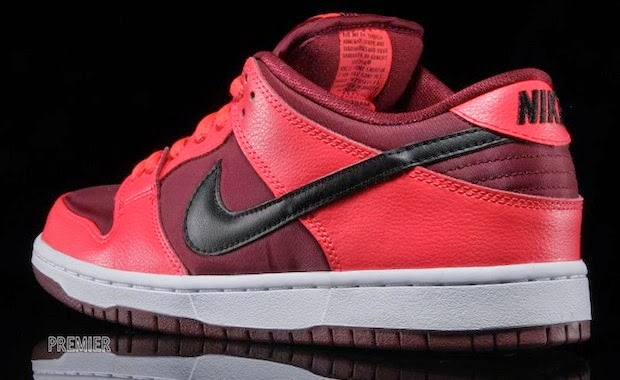 f3b6f388b522 ... The Nike SB Laser Crimson Dunk Low is painted red with a black leather  Swoosh and ...