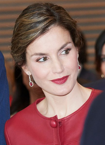 Queen Letizia wore CAROLINA HERRERA Peplum Jacket, LODI Pumps Shoes, carries UTERQUE Snakeskin Clutch