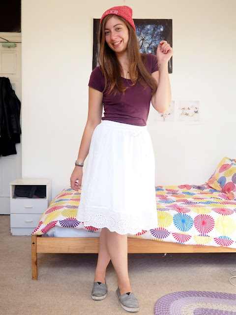 Aladdin inspired Disneybound outfit of dark purple top, long white skirt, grey Toms shoes and red beanie hat