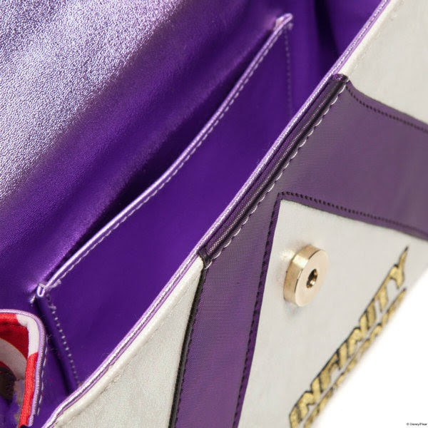 close up of metallic purple lining inside clutch bag