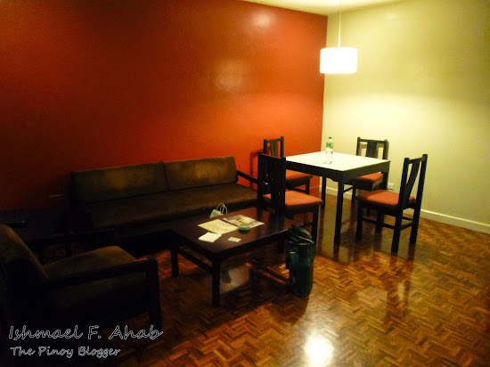 Living and dining areas in Copacabana Apartment Hotel