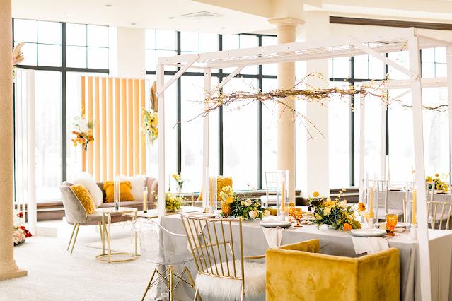 white and yellow reception decor