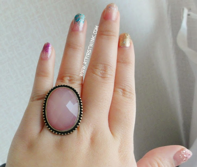 New Look ring with large pink gem stone and pretty nails