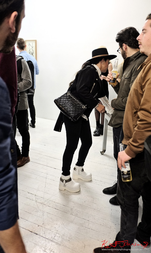 Black hat pants jackets and Chanel bag with white boots. Street Fashion Sydney at China Heights - Photo by Kent Johnson.
