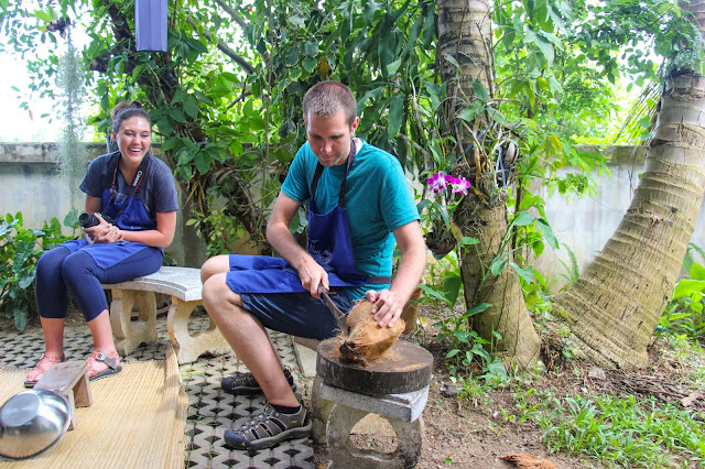 Thai Secret Cooking Class Cracking coconuts to make home made coconut milk. June 22-2017