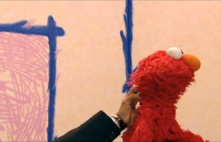 The hand scratches his back and says Elmo's furry. Sesame Street Elmo's World Hands Interview