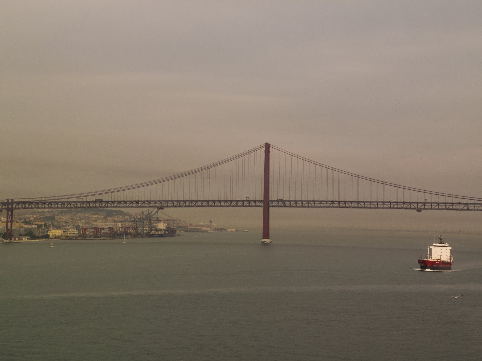 View of Lisbon's suspension bridge from the Tagus River.