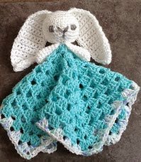 http://www.ravelry.com/patterns/library/cute-bunny-comforter---lovey
