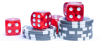 Dice on a short stack of poker chips.