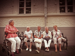 older women sitting on a bench