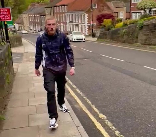 Sheffield United player Oliver McBurnie is seen having an altercation with a man in the street