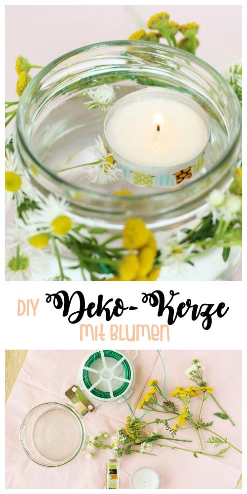 Deko-Kerze mit frischen Blumen