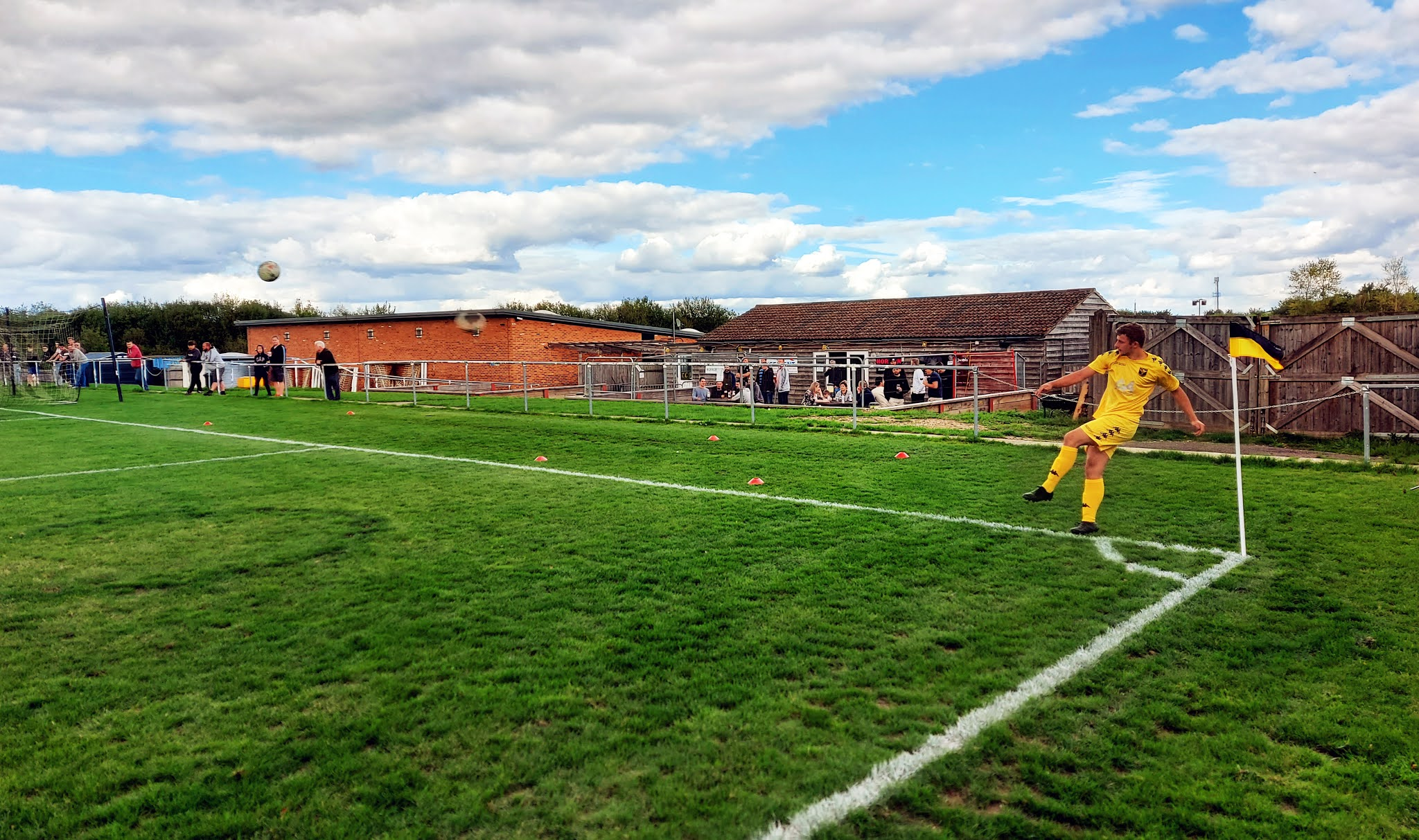 A Tadley Calleva player taking a corner as fans watch on at Barlow's Park
