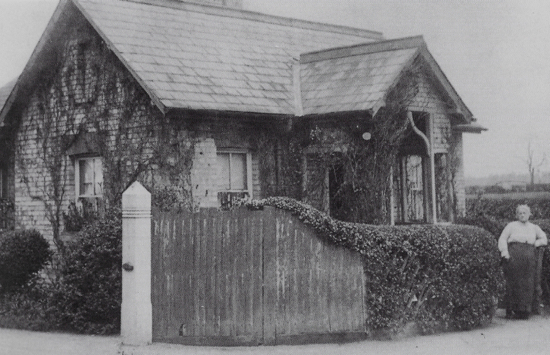 Photograph of the lodge at Hawkshead House c 1890 Probably Mary Hewitt, wife of John Hewitt, Bill Nott's grandfather, who was head gardener to Mr T B Forwood