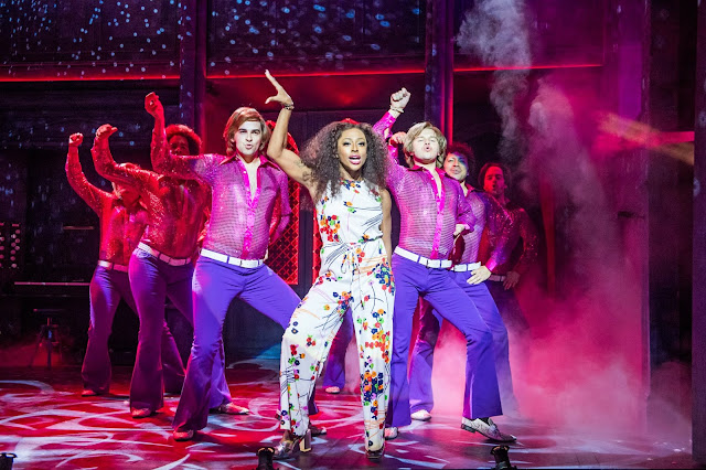 Alexandra Burke and the male cast of Sister Act in a dance performance.