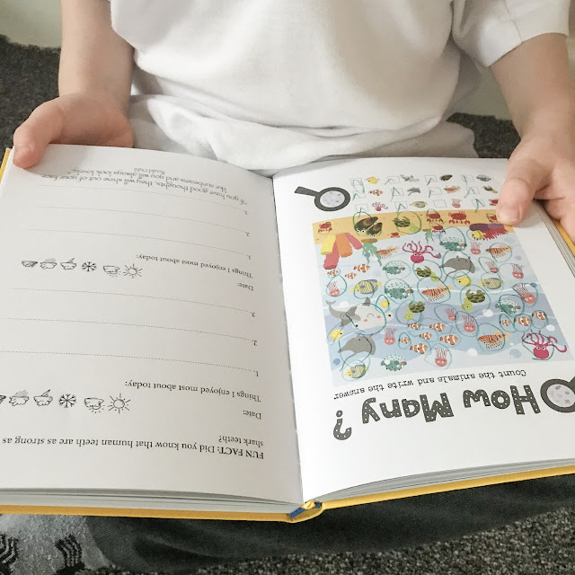 Open journal being held by a child