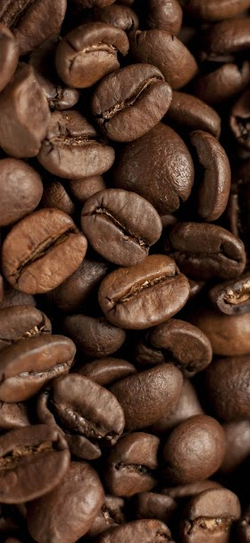 خلفية حبوب القهوة البنية المحمصة جاهزة للتحضير