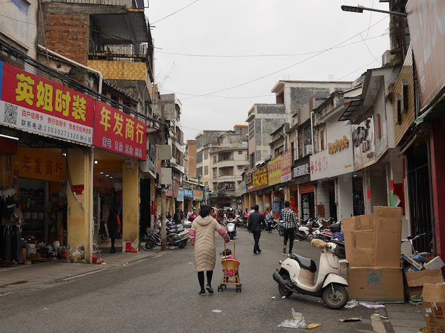 woman pushing a baby stroller on Jiefang East Road in Yunfu