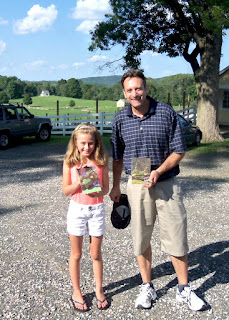 Jim Laurino, guest teacher, pictured with a young student, Annie, and her first plein air painting.