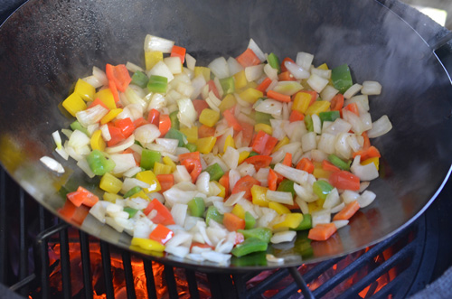 Stir-frying on the Big Green Egg is a good way to take advantage of a kamado grill's high heat capability.