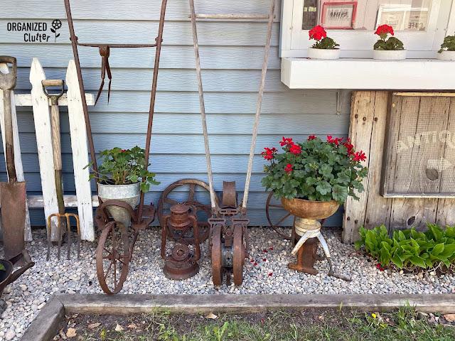 Photo of junk garden decor along the house