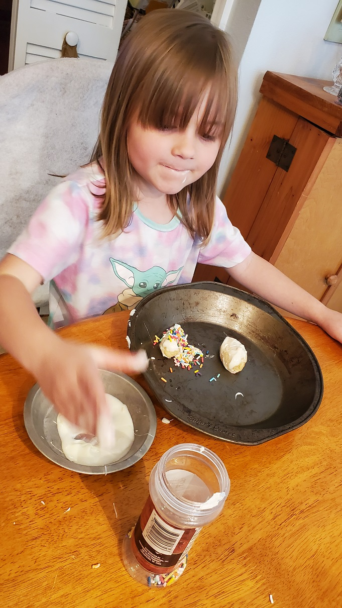 this is Talia who is making sugar cookie mix truffles with Grandma and only 4 years old
