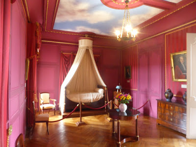 a rather pink  bedroom at Chateau de Villandry in the Loire Valley including canopied bed