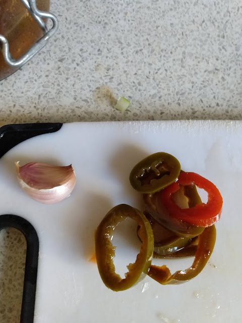 Garlic and pickled jalopeno peppers for flavouring