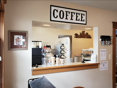 color photo of coffee window inside Grafton Illinois coffee antiques shop Lightkeepers Coffee 101 E Main St Sears Vallonia