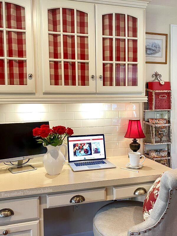 Cottage Style Desk Area with red check fabric on cabinet doors