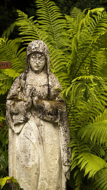 Places to Visit in Zurich in One Day with a ZVV Day Pass: weathered Virgin Mary statue in Friedhof Fluntern cemetery
