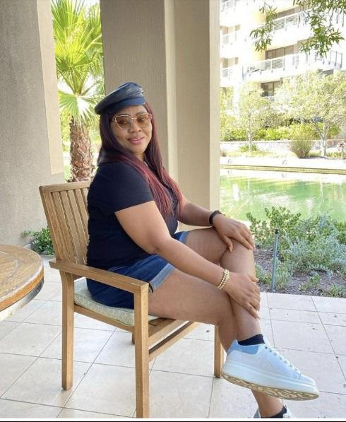 """Your Mates Are Happily Married"" – Regina Daniels Mother Dragged Mercilessly For Sharing Photo of Herself In Bum Short"
