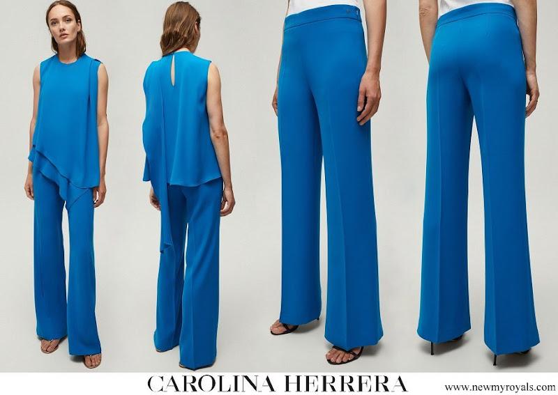 Queen Mathilde wore Carolina Herrera crepe straight leg pants blue
