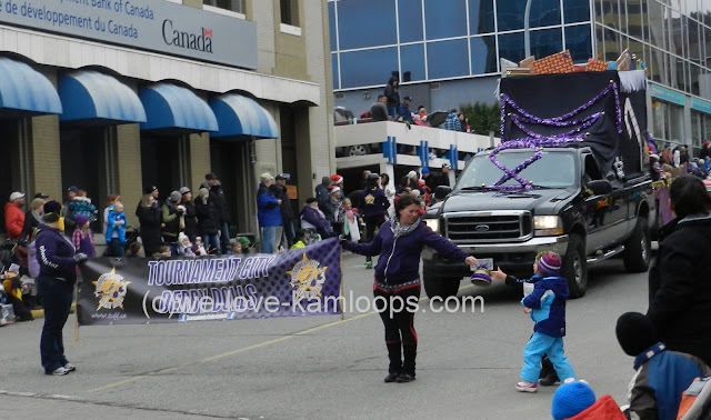 Derby Dolls carry a banner in the Santa parade