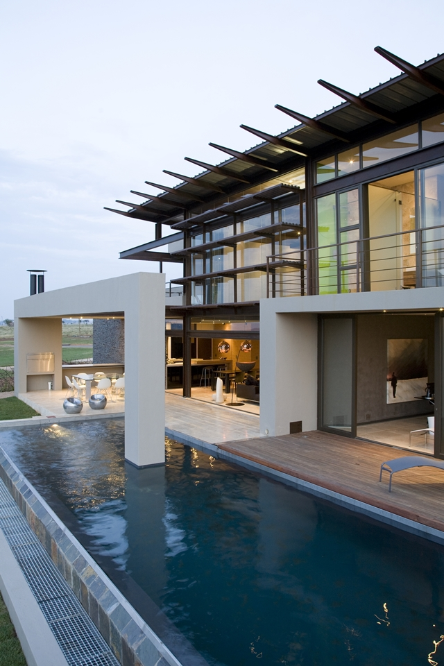 large luxury terrace and swimming pool of Serengeti House by Nico van der Meulen Architects