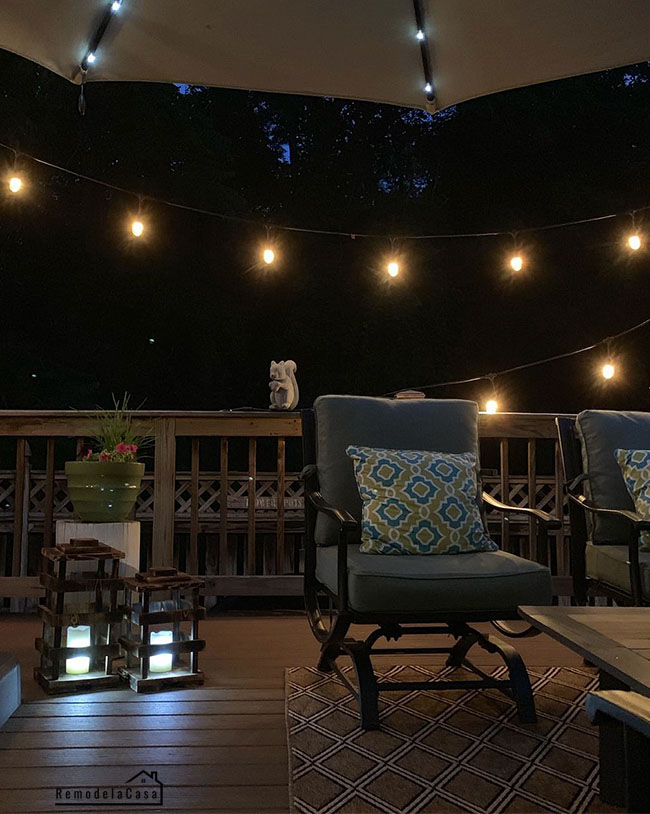 Deck with fairy lights and rustic lantern set