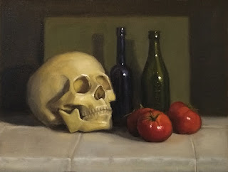 Still life oil painting of a plastic skull beside several tomatoes and some antique bottles.